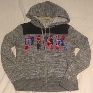 A PINK full-zip hoodie with adjustable drawstrings